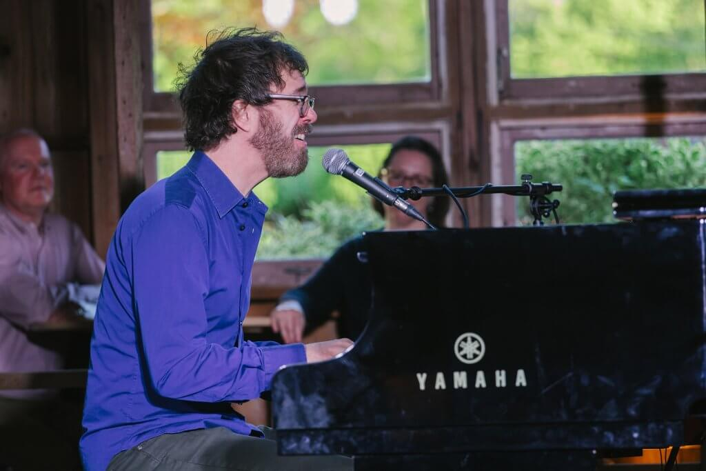 ben folds performance ct at grand piano